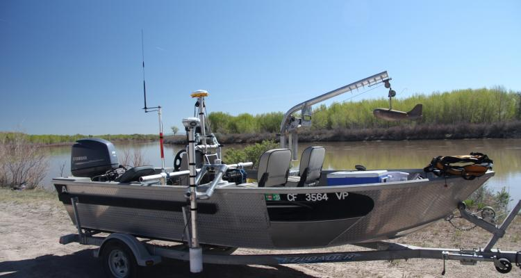 19-ft jet boat set up with ADCP, GPS, and sediment sampling equipment
